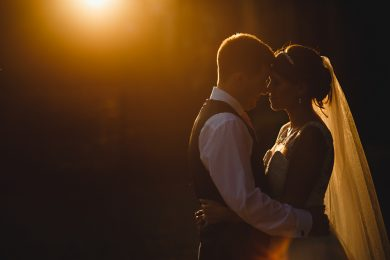 the bride and groom stood in golden orange sunset at Hoar Cross Hall in Staffordshire