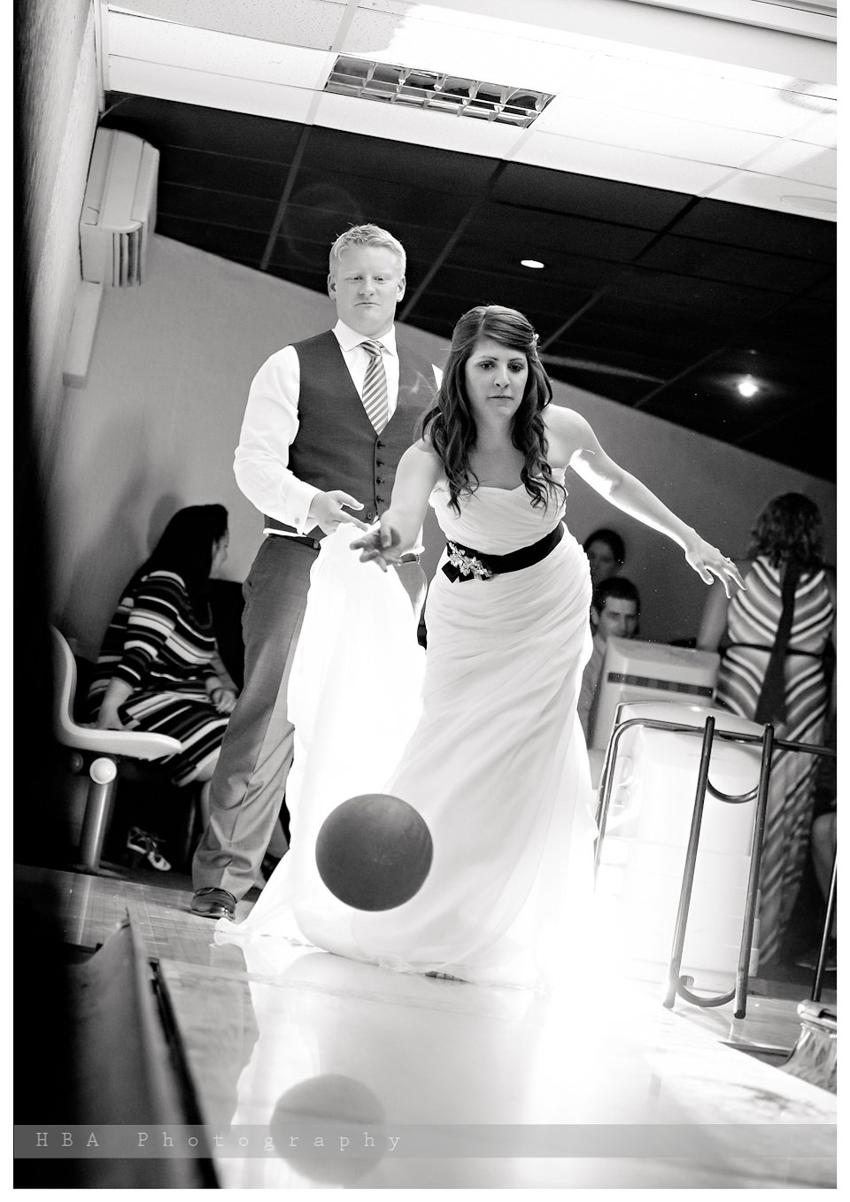 The wedding of Josey & Sam at Hellidon Lakes Golf & Spa Hotel, by contemporary Derbyshire photographers HBA Photography. A bit of bowling after dinner