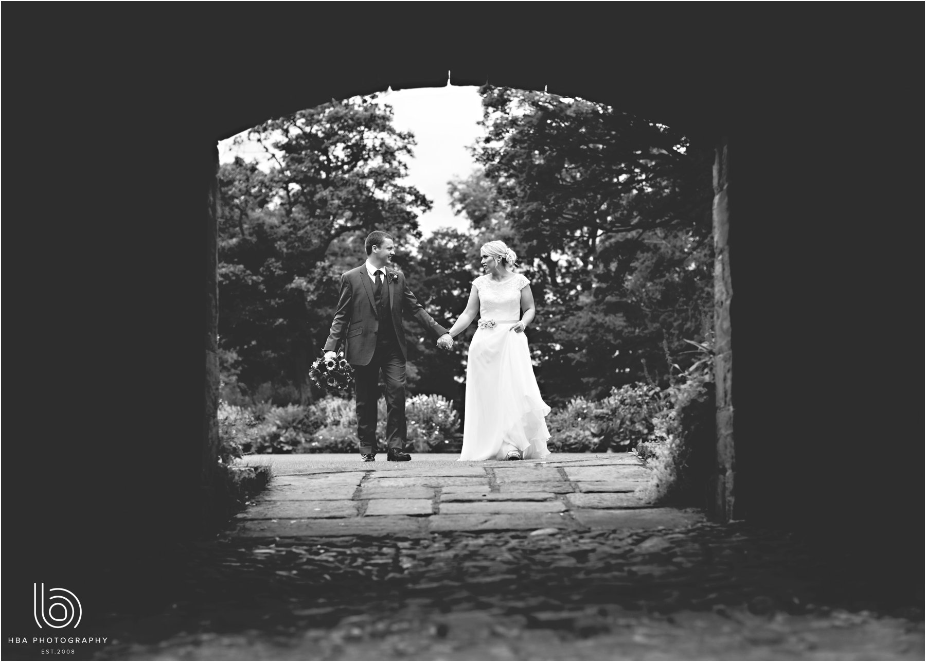 the bride & groom under the arch