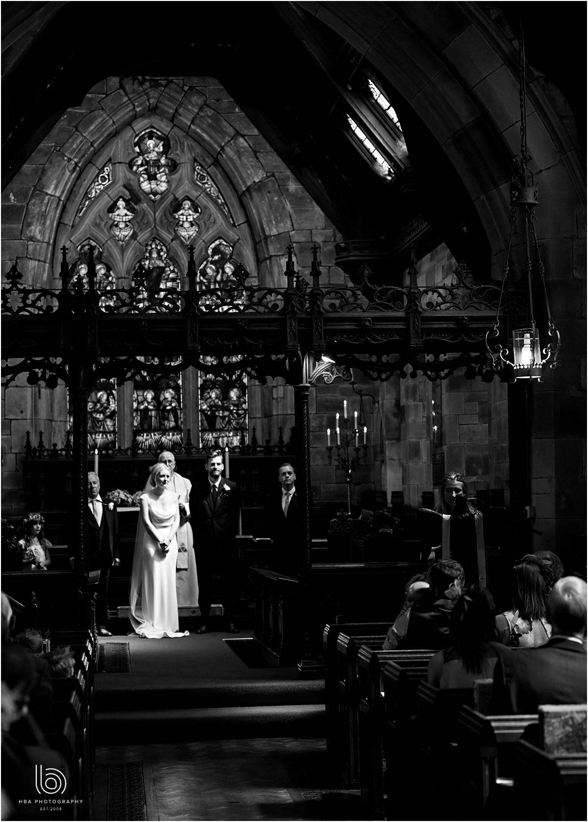 the bride and groom in church in black and white