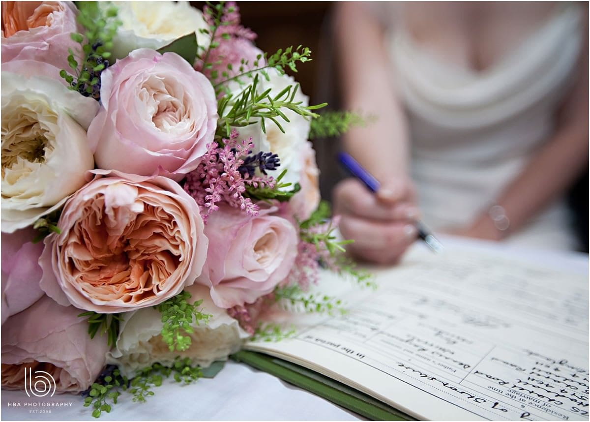 signing the register with pink flowers