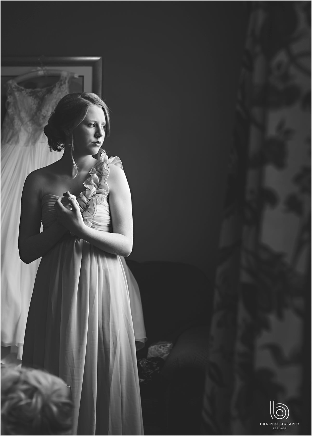 a black and white photo stood in beautiful window light
