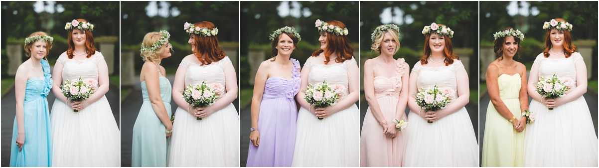 the bride and her bridesmaids all dressed in different pastel dresses