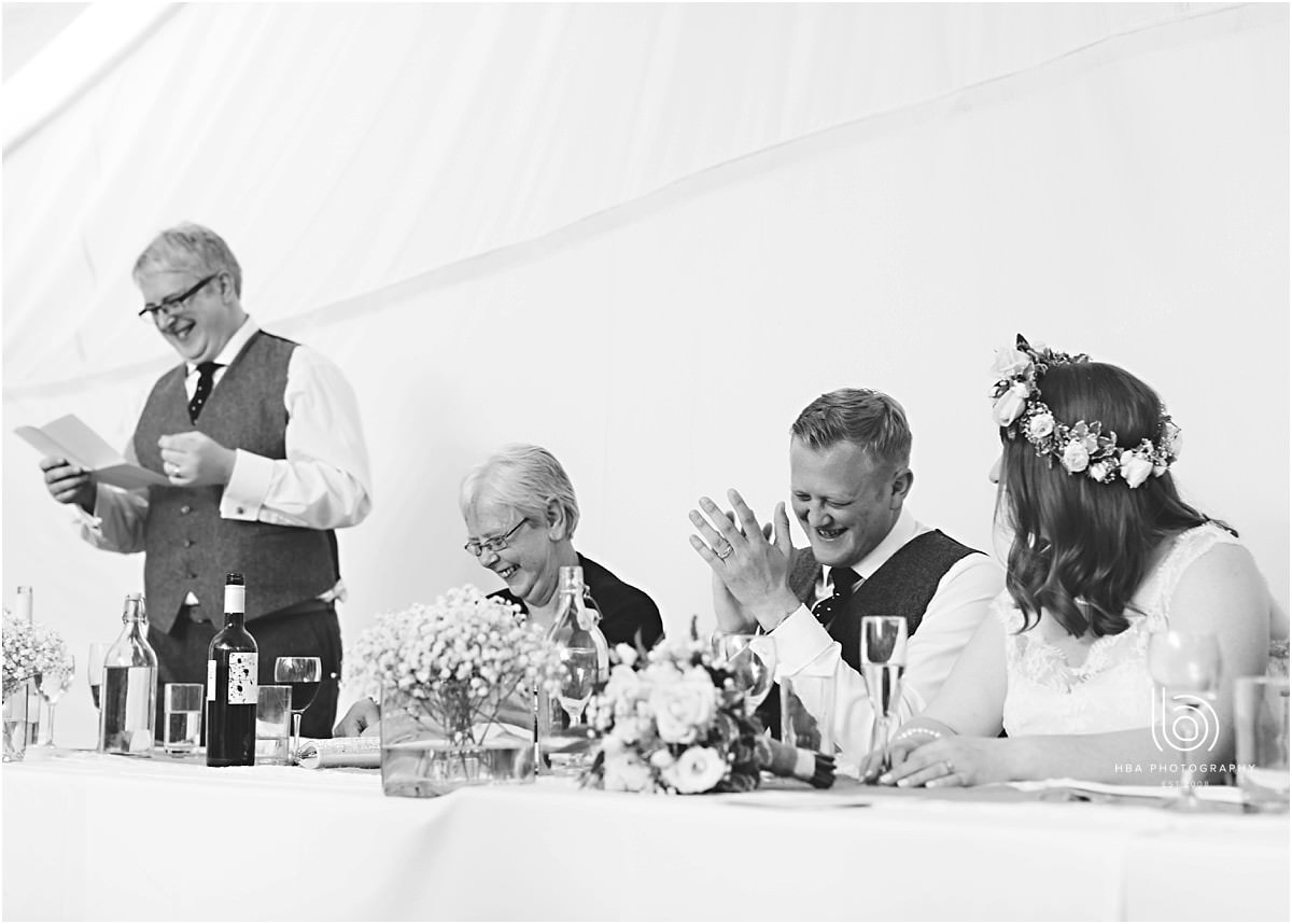 black and white photos of the best man giving his speech