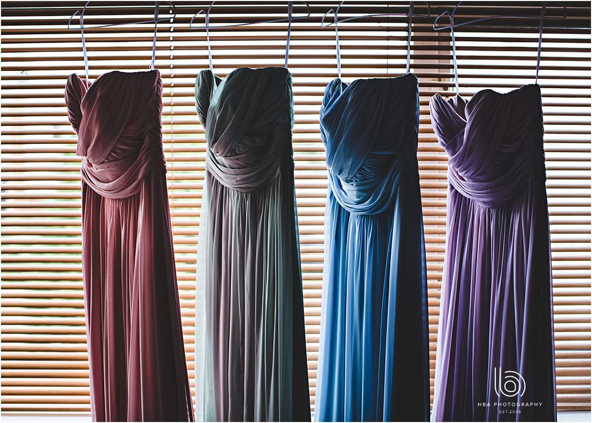 The bridesmaids dresses hanging up