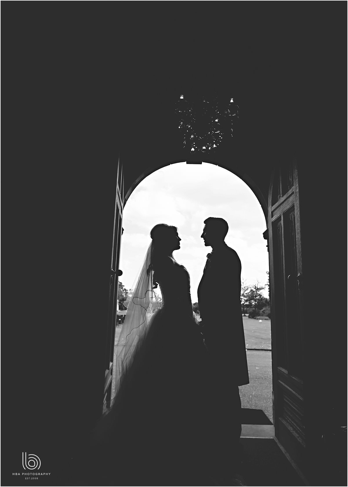 he bride and groom in silhouette at Wrenbury Hall