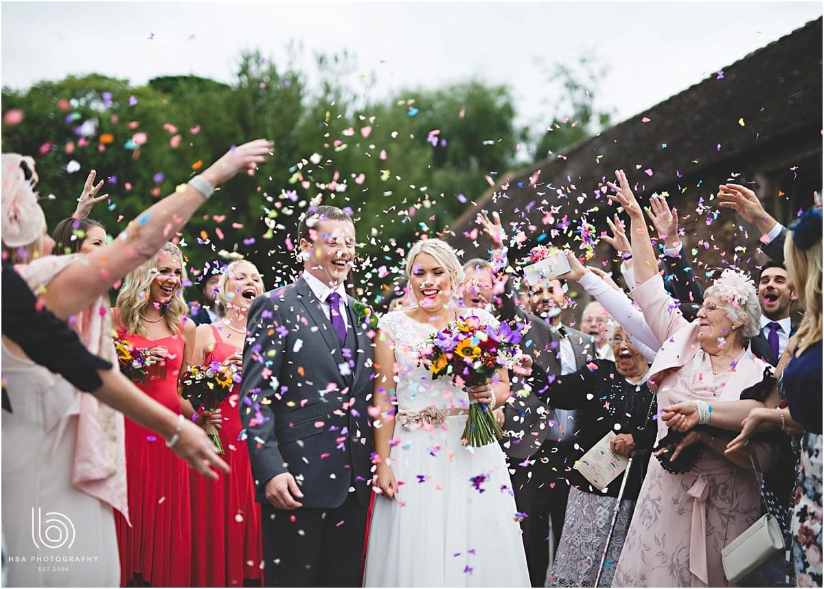 the bride and groom covered in confetti