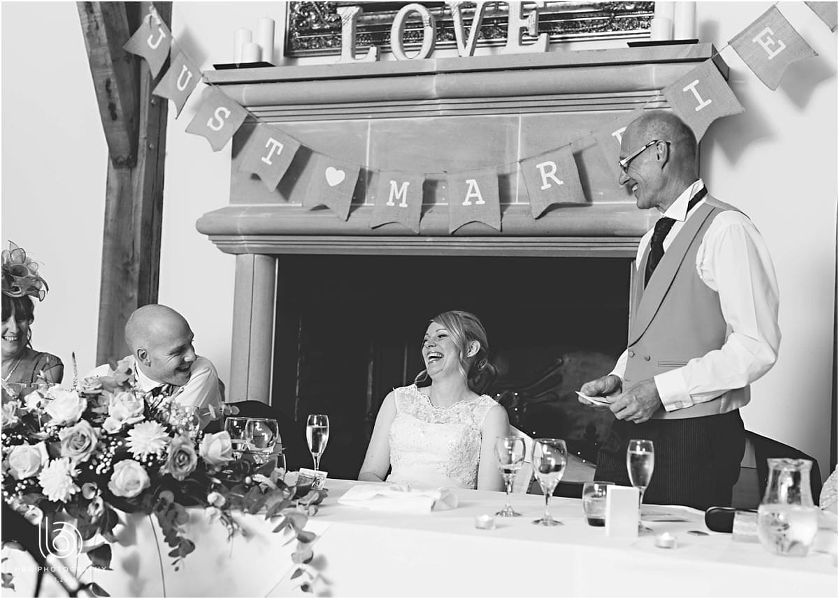 the bride laughing at her dad speech