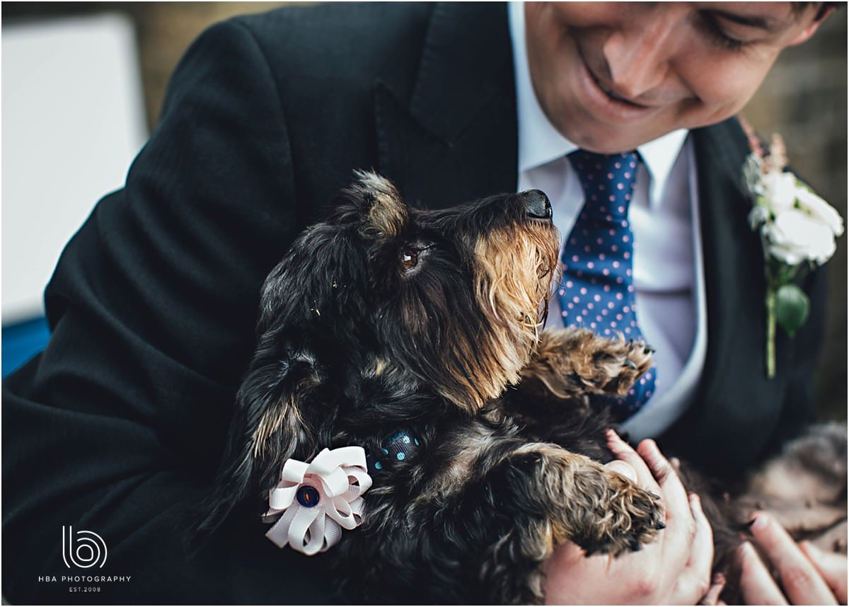 the groom holding the family dog