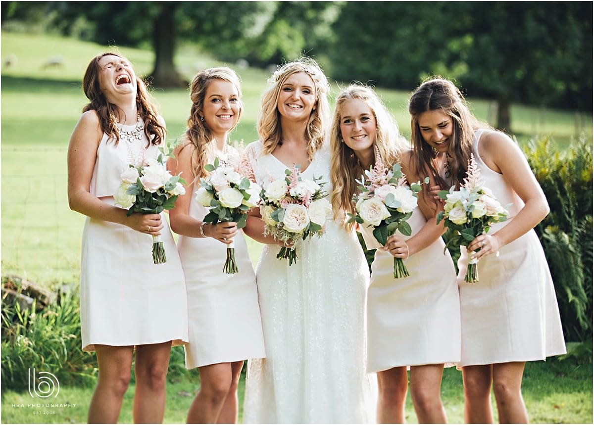 the bride with all her bridesmaids