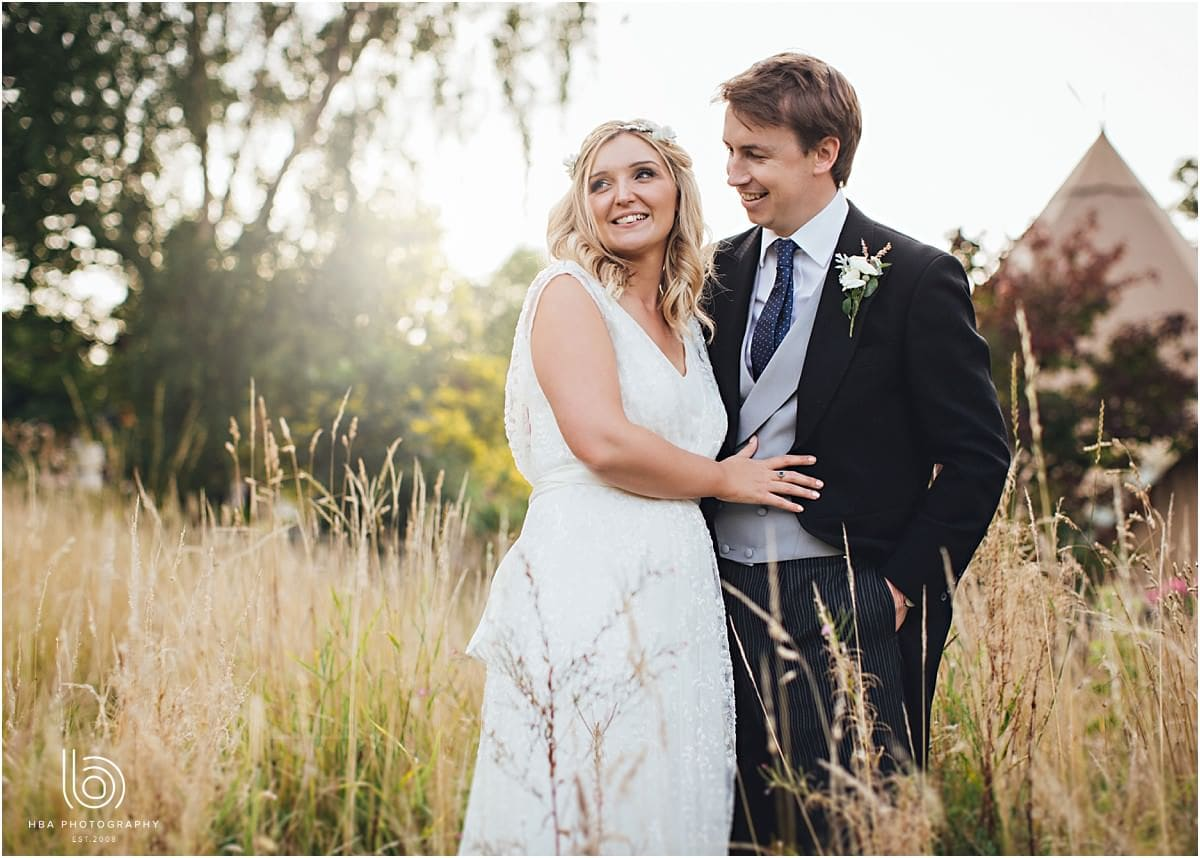 the bride and groom in a meadow