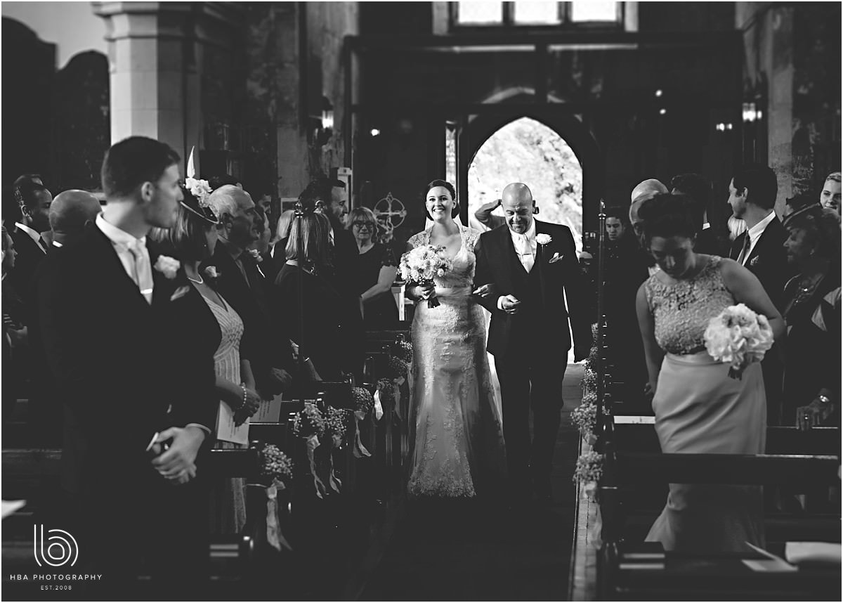 black and white shot of the bride walking down the isle
