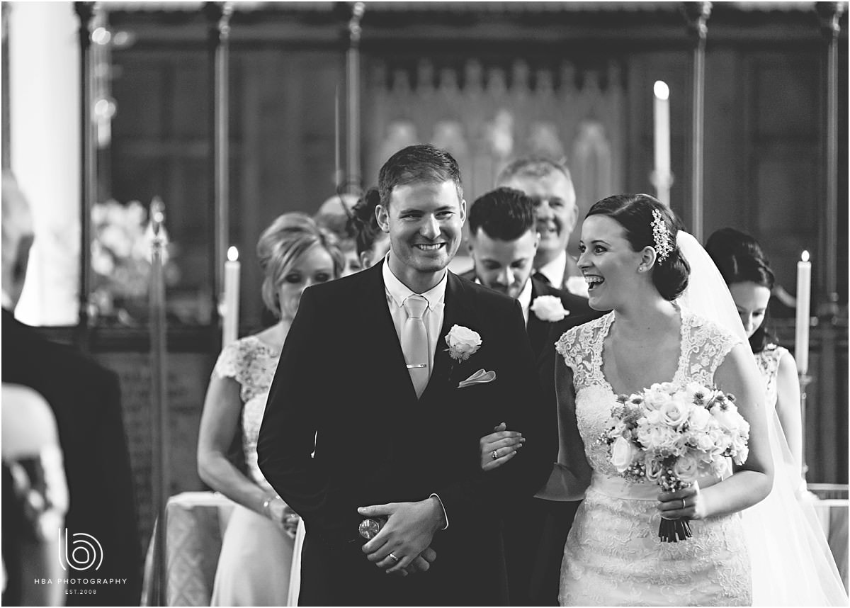 the bride and groom smiling in church