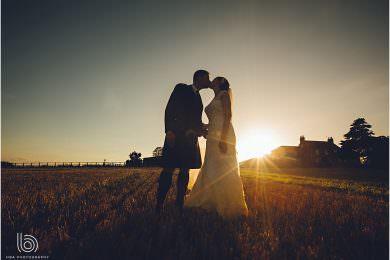 a beautiful sunset sharing a kiss