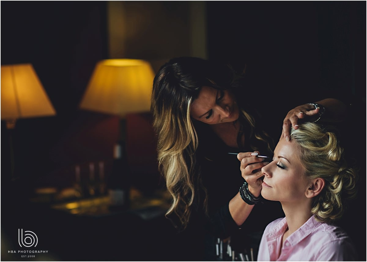 the bride having her makeup done