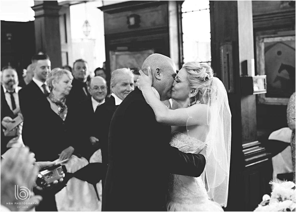 the bride and grooms first kiss