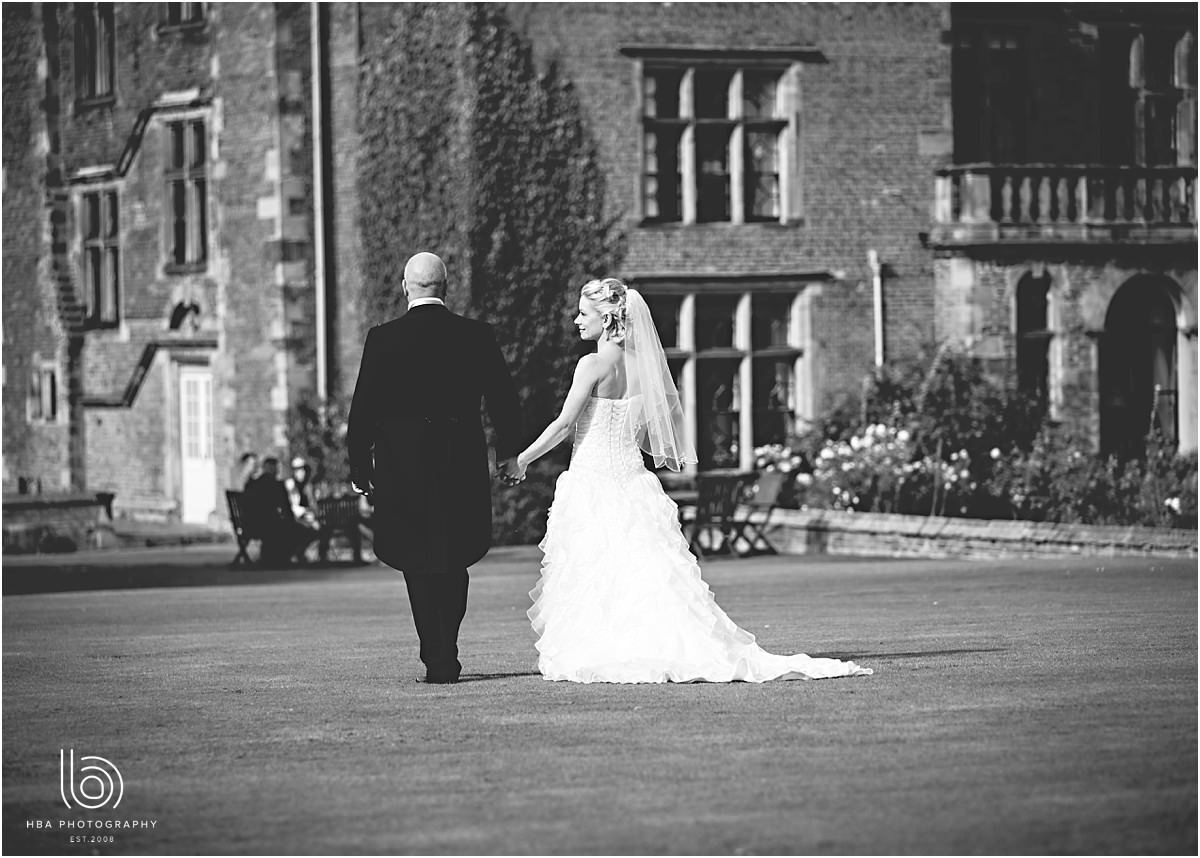 the bride and groom walking towards Thrumpton Hall