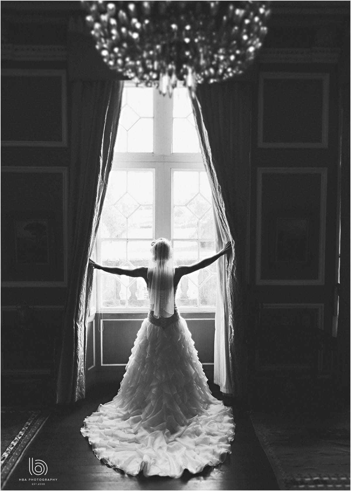the bride in one of the windows at Thrumpton Hall