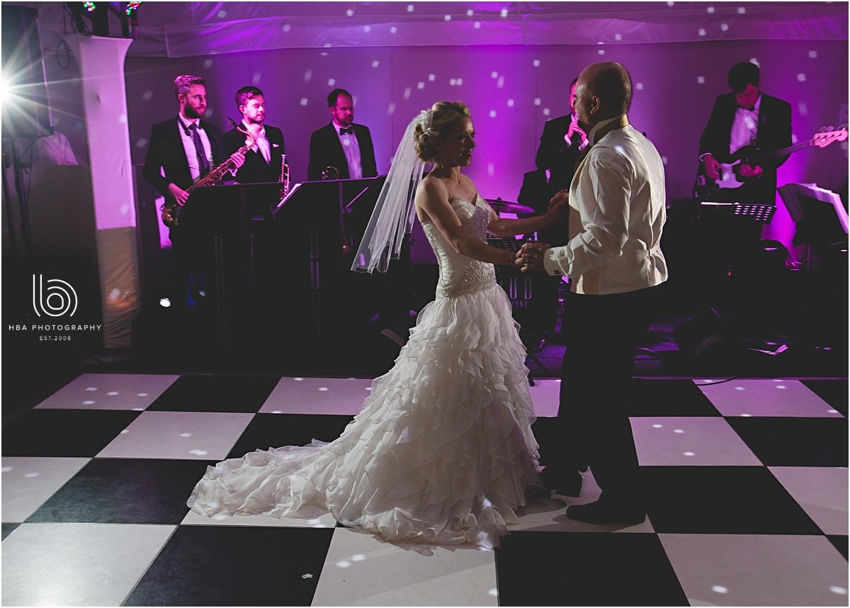 the bride and groom in the their first dance
