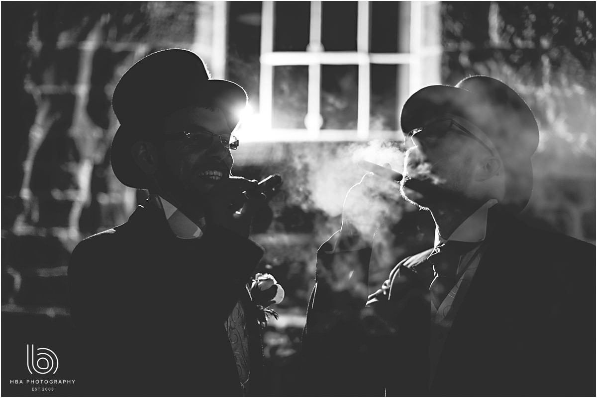 the groom and best man smoling cigars