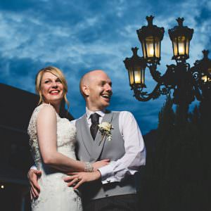 A couple stood by a lamp post at Swancar