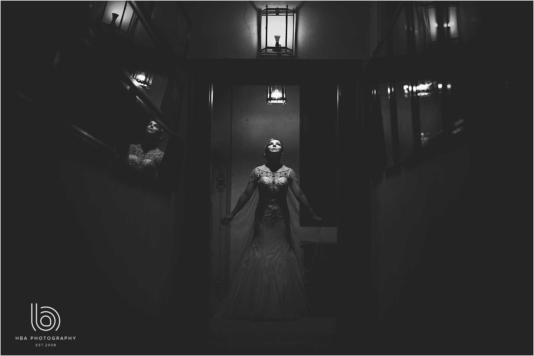 the bride stood in the dark at the end of the hallway at Hardwick Hall