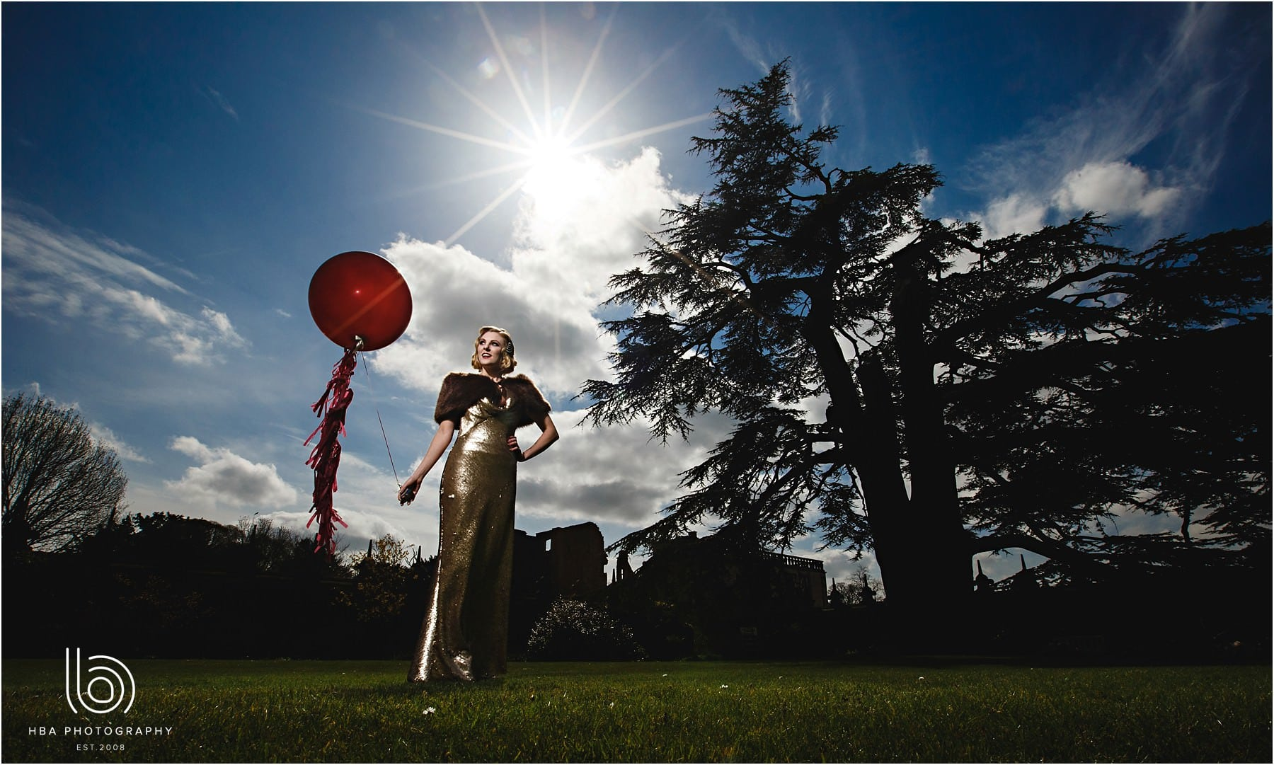 the bride holding a big red balloon