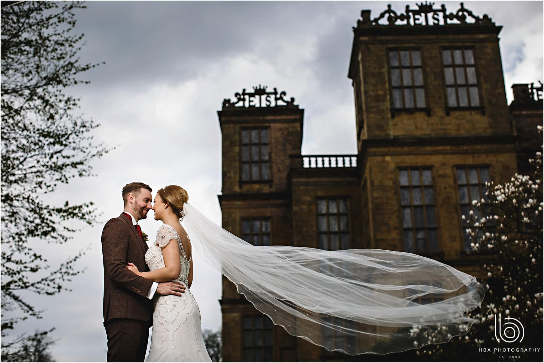The bride and groom stood outside Hardwick Hall