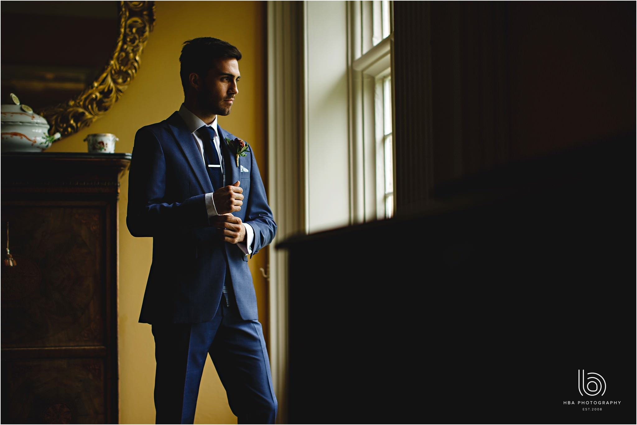 the groom in his custom made suit
