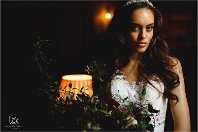 the bride with orange lights behind her