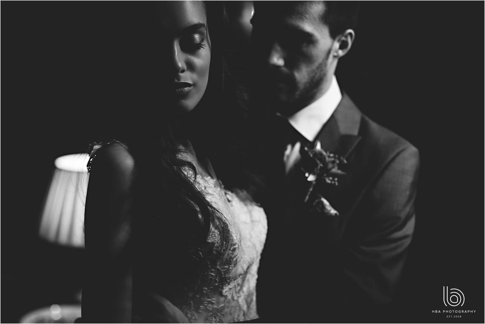 a dark portrait with a bride and groom