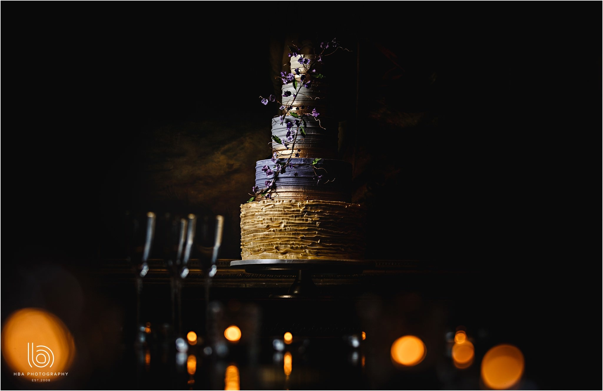 an amazing 5 tier wedding cake with real gold leaf