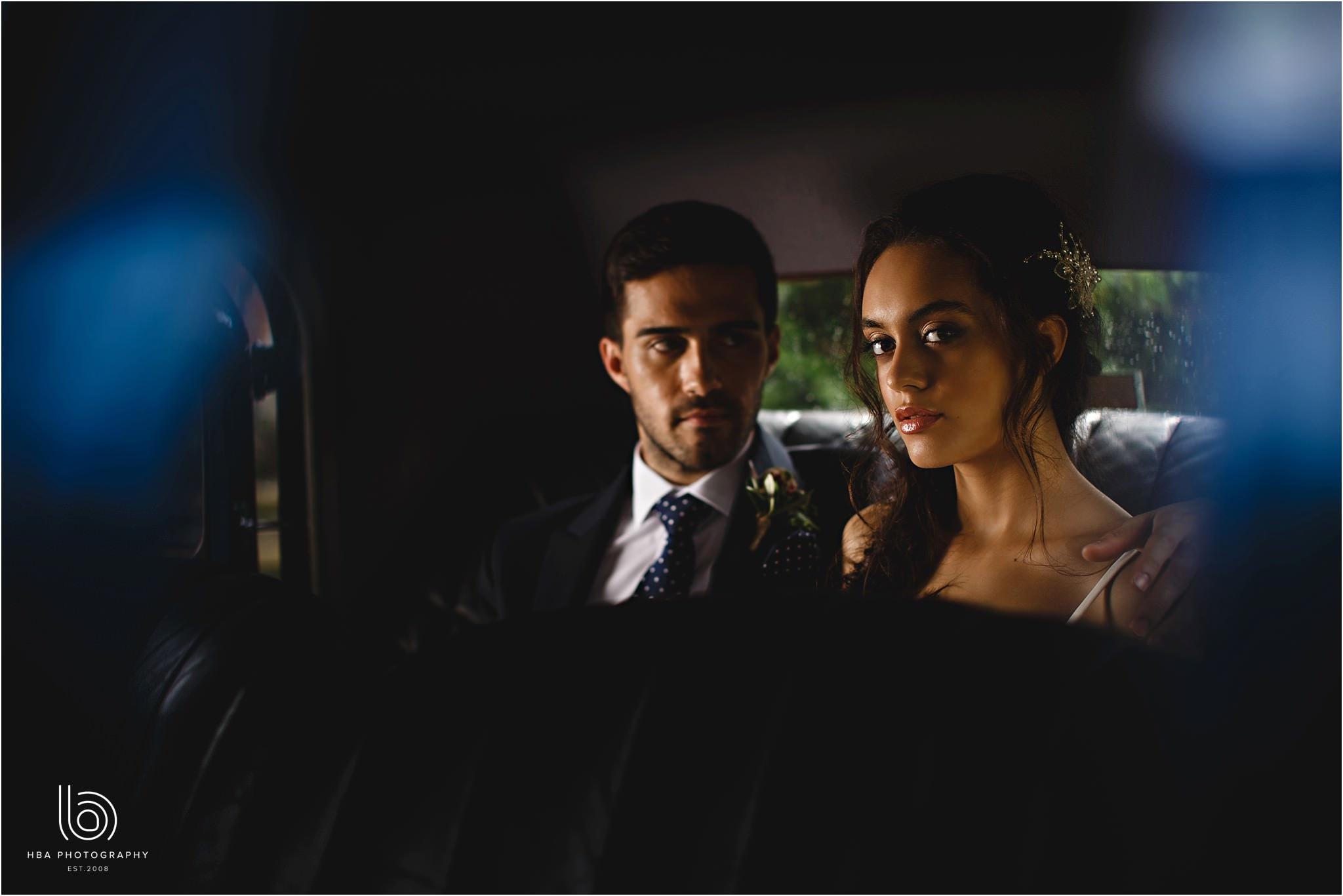the bride and groom sat in the Bentley wedding car