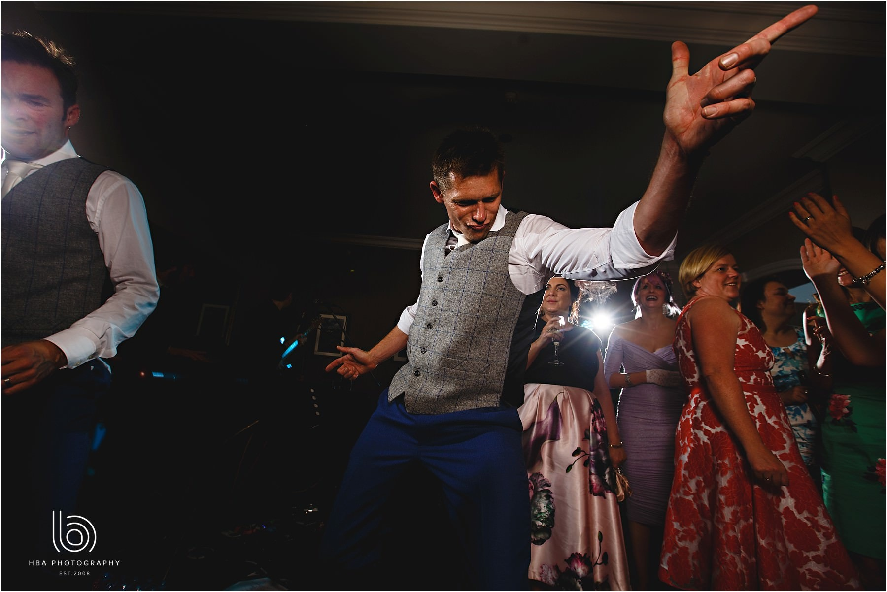 the best man and groom dancing