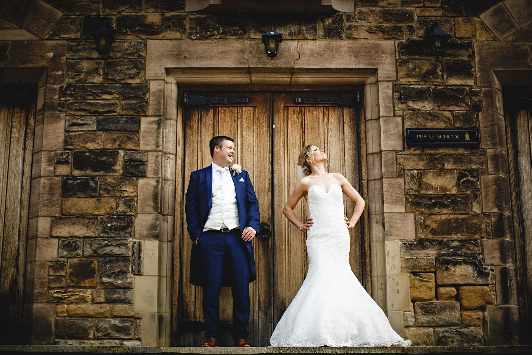 The bride and groom stood in the church doors in Repton Derbyshire before heading to Yeldersley Hall