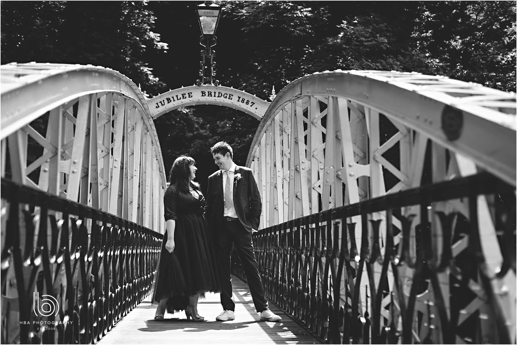 the bride & groom on the bridge