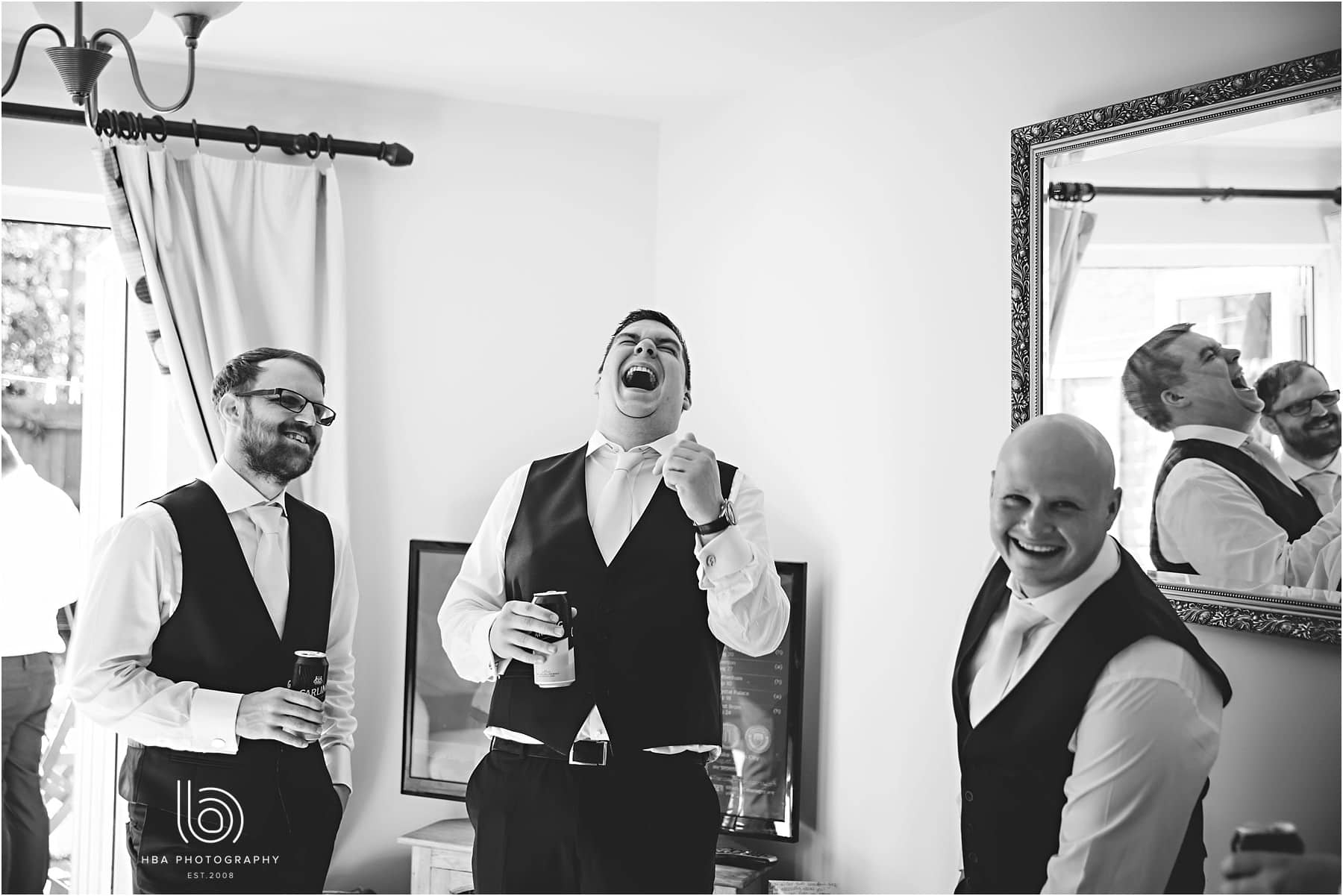 all the groomsmen laughing