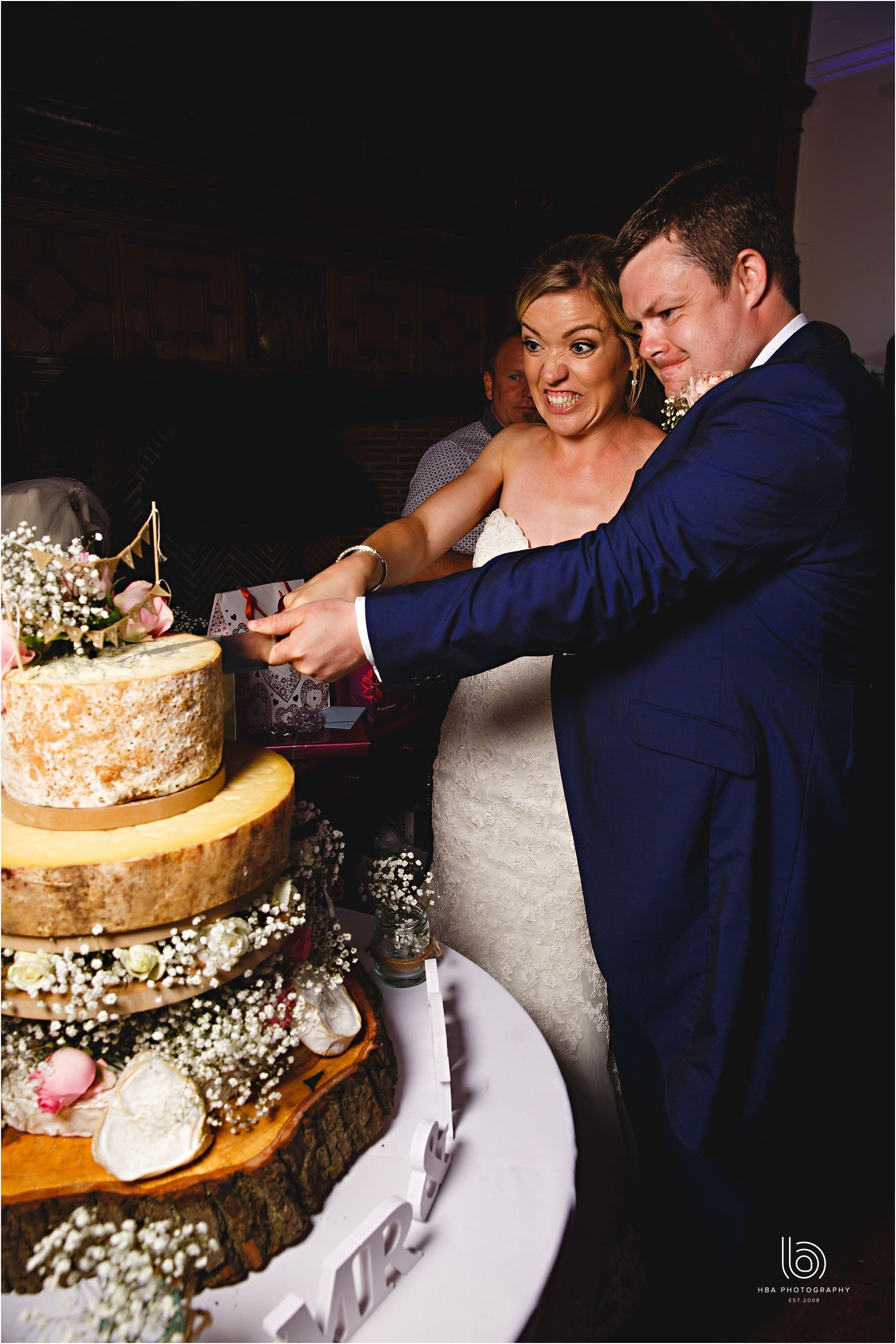 the bride & groom cutting their cheese cake