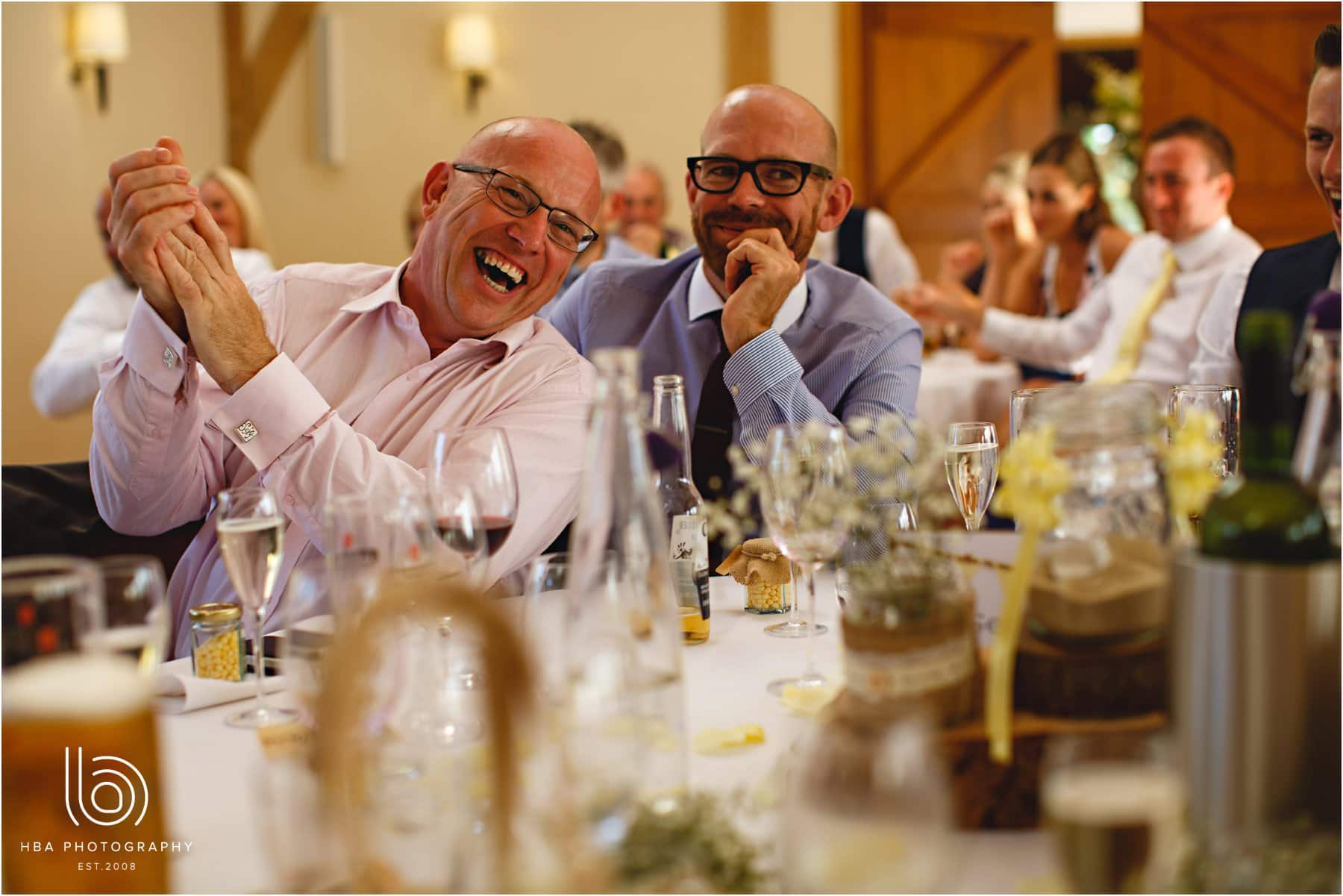 guests laughing at the speeches