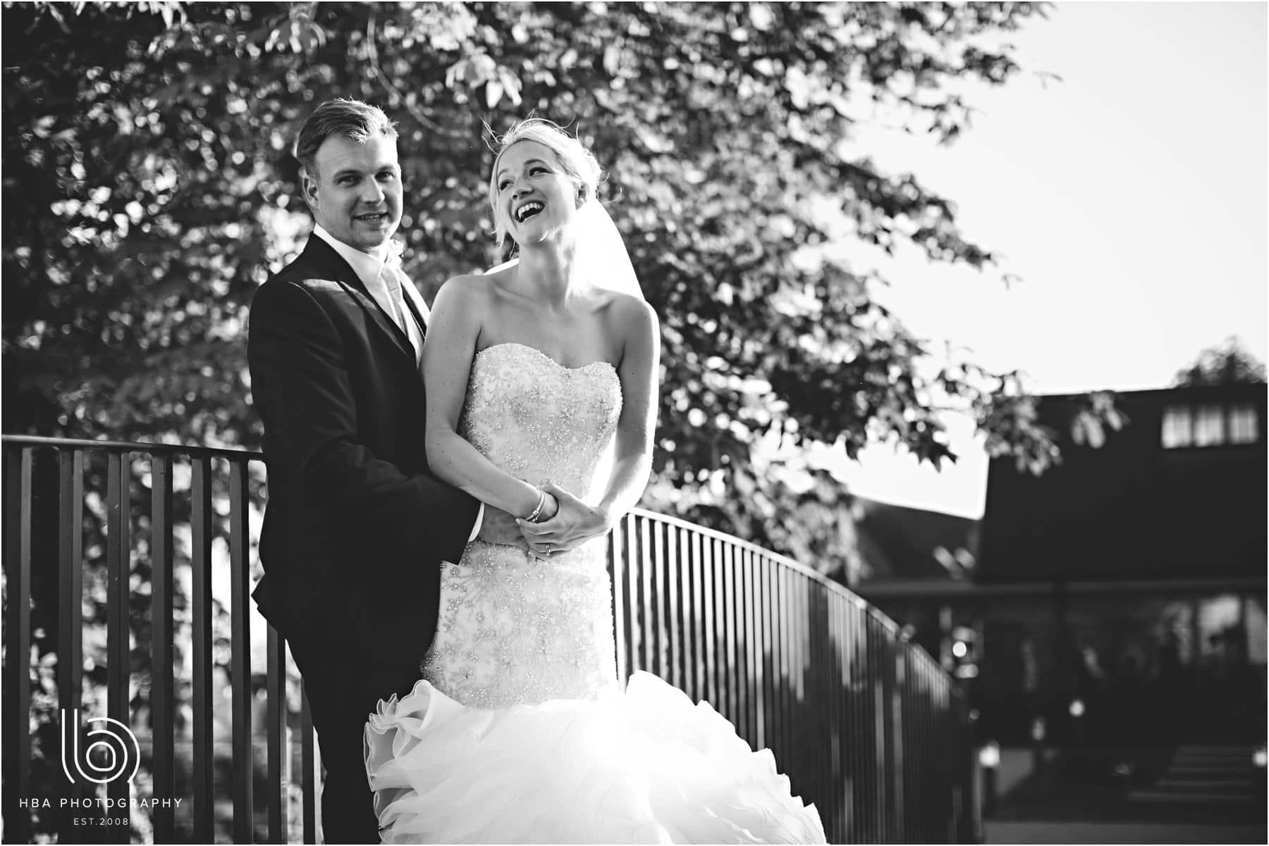 the bride & Groom on a bridge