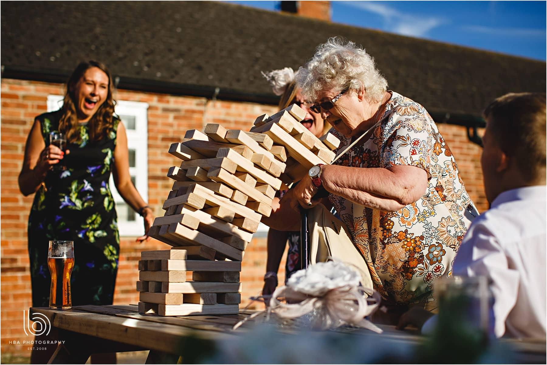 grandma playing giant jenga