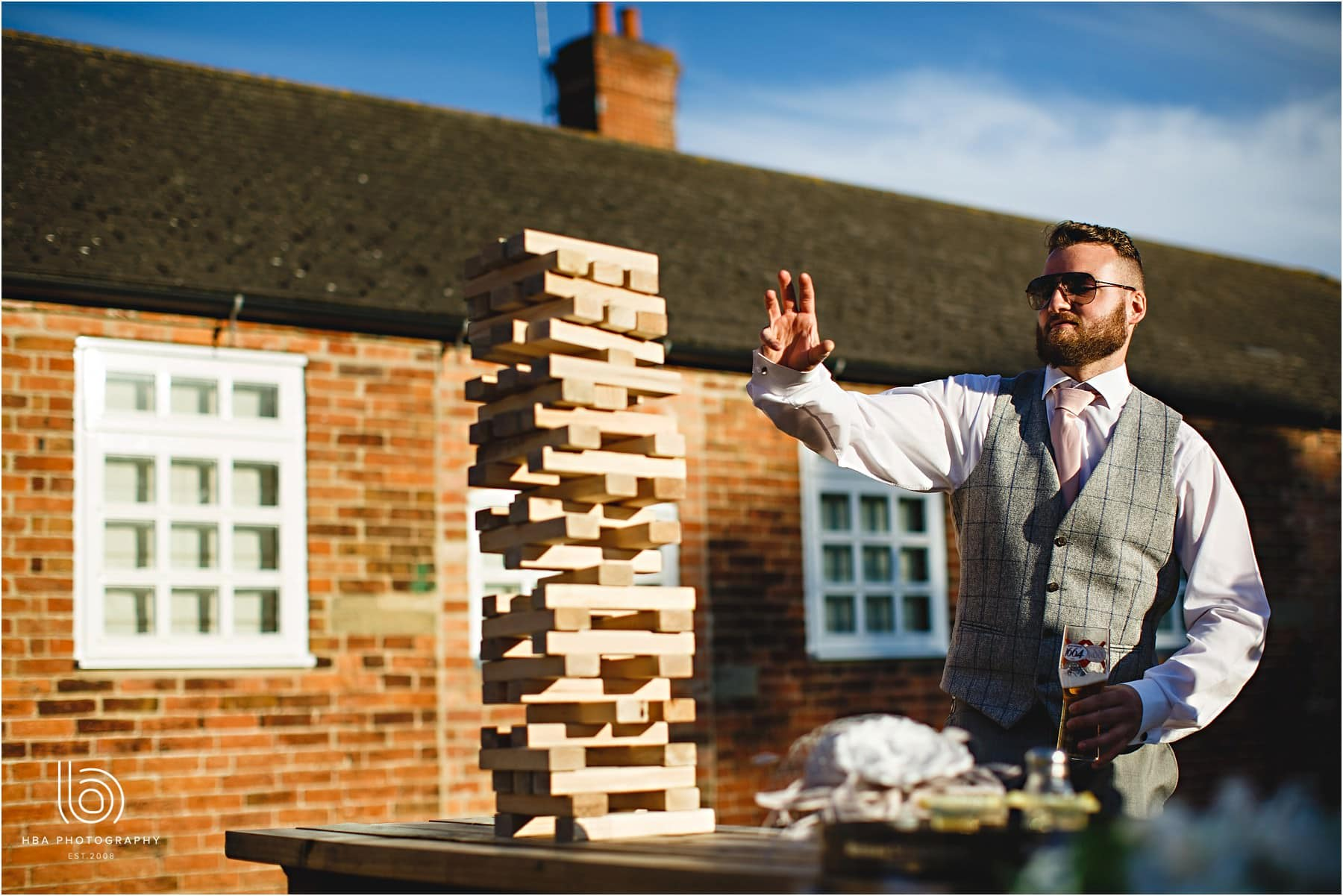guests playing giant jenga at a wedding