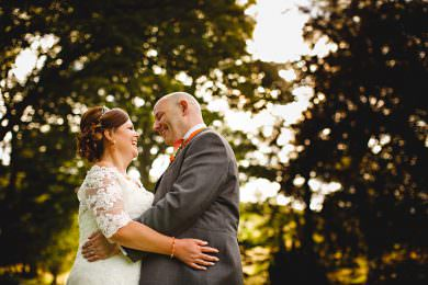 The bride and groom in golden sunlight at Losehill house in Derbyshire