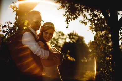The bride and groom in golden sunlight at Mythe Barn