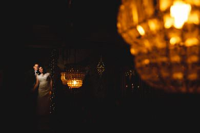 the bride and groom in amongst dark lights at the city rooms in Leicester