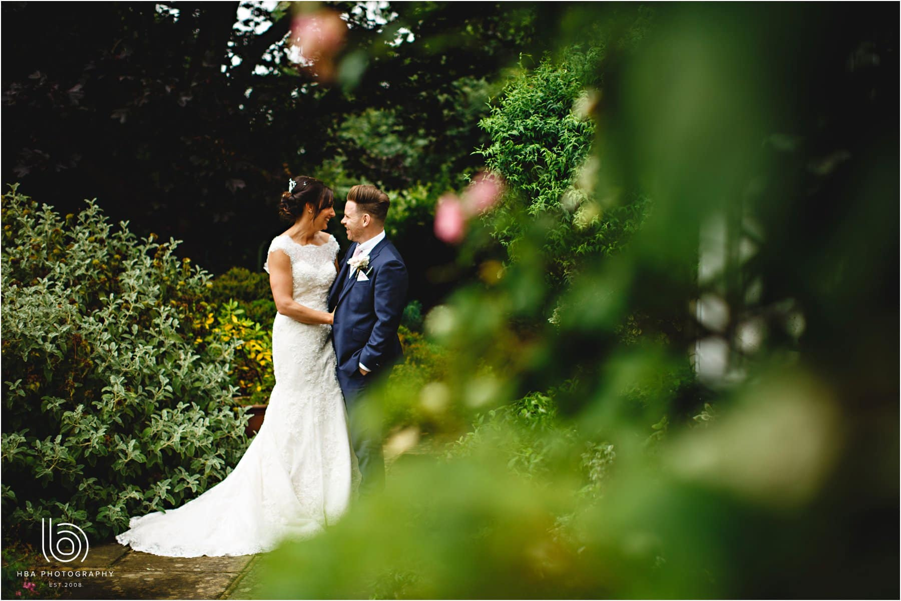 the bride and groom in the gardens