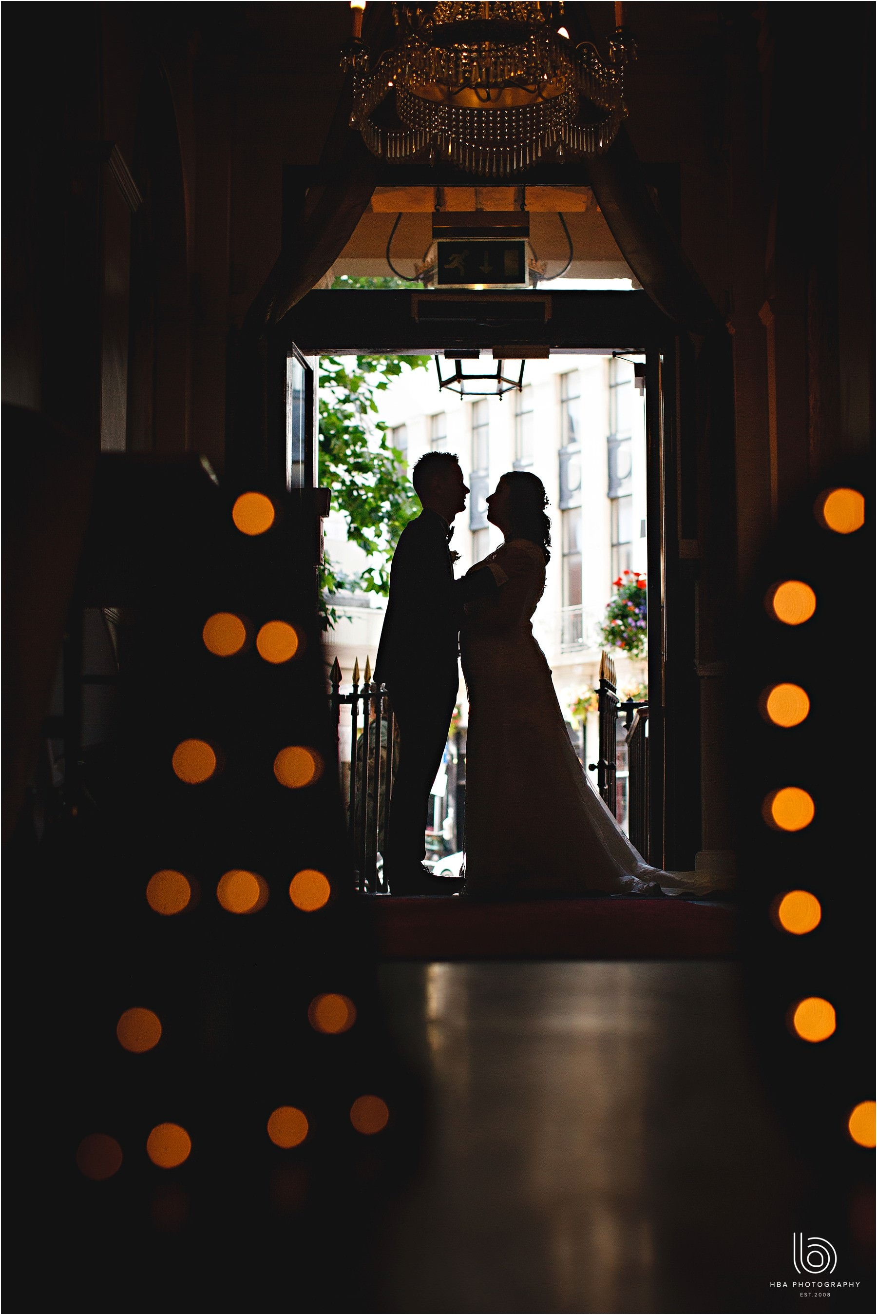 the bride and groom in silhouette