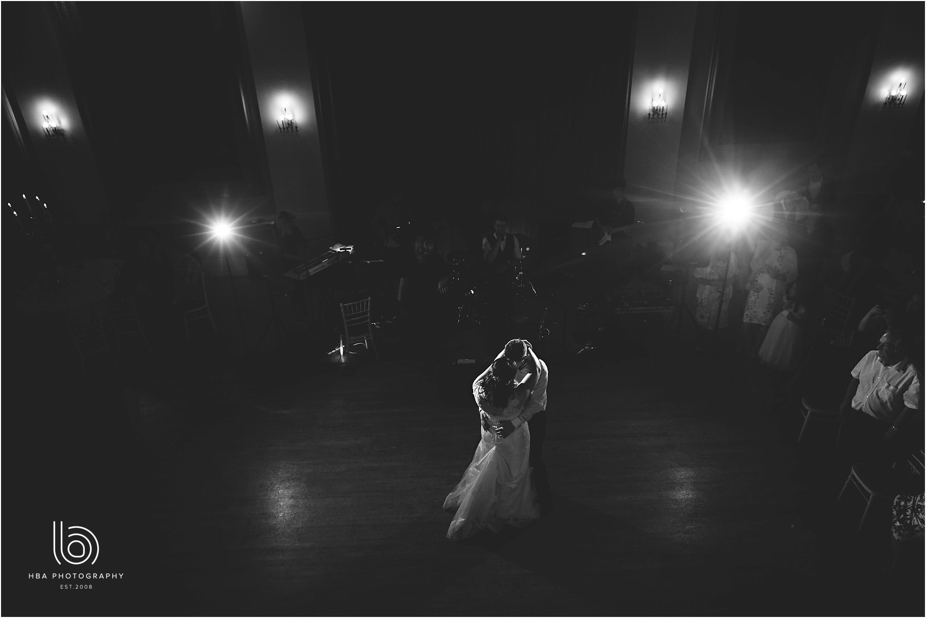 a black and white photo of the first dance as husband and wife