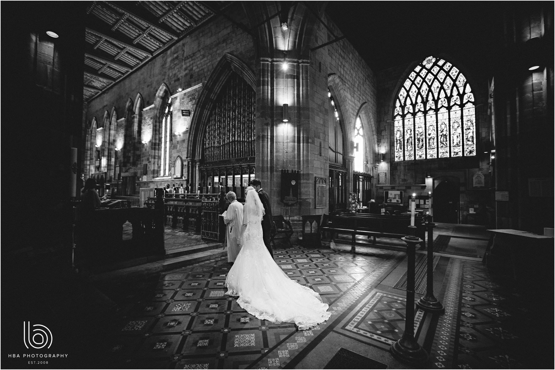 the bride and groom getting married at St Oswalds in Ashbourne