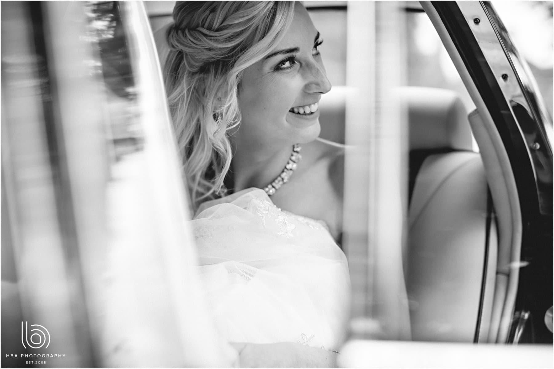 the bride in the wedding car